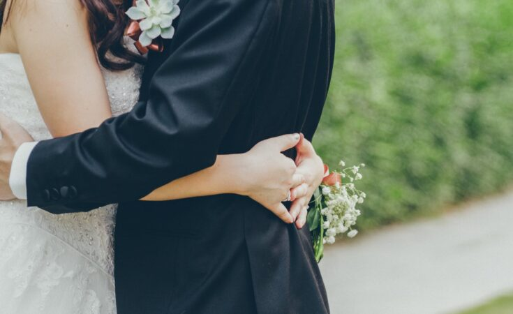 photo of bride and groomhugging